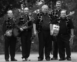 MEMBERS OF KANSAS CITY PRIEST BAND - Members of the Priest Band are, from left, Father Kent O'Connor, Father Mark Mertes, Father Ken Kelly, Father John Reynolds and Carl Parry. The four priests of the Archdiocese of Kansas City, Kan., and Parry, a layman who is studying for the permanent d iaconate, have been putting in a lot of hours lately, rehearsing for their next gig. (CNS/The Leaven)