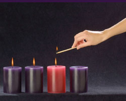 CANDLE FOR THIRD WEEK OF ADVENT -  The rose colored candle represents is lit during the third week of Advent and the color represents a hopeful look toward Christ's coming. (CNS)