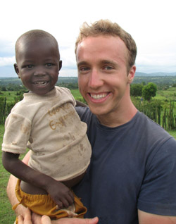 ACTIVIST PICTURED WITH KENYAN BOY - Craig Kielburger, the longtime youth activist who has worked to improve conditions for young people around the world, poses with a Kenyan boy in 2006. (CNS Photo)