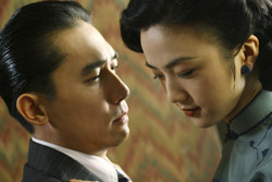 'LUST, CAUTION' – Tang Wei, left, and Tony Leung star in a scene from the movie 'Lust, Caution.' (CNS/Focus)