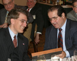 Justice Scalia admires an icon of Elijah the Prophet presented to senior editor Robert P. George at a Touchstone-sponsored dinner in Washington D.C. on May 3rd of last year honoring Dr. George for his achievement in service to the nation and the church.