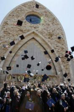 The graduates of Ave Maria University engage in this traditional celebrative act in front of the Oratory on the main Campus in Southwestern Florida.