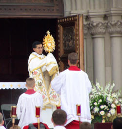 The Knights leading the faithful to Adore the Eucharistic Lord on the Feast of Corpus Christi.