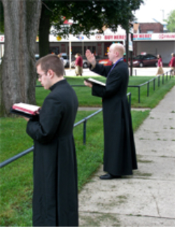 The priests in Rockford quietly stand vigil in every type of inclement weather with open coats, so that the women seeking an abortion are aware that a priest is present in his flowing, seemingly flaming cassock.