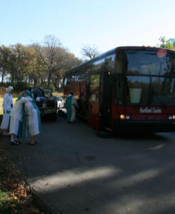 Intercessors of the Lamb getting on the bus as they leave their former residence at the direction of the Bishop.