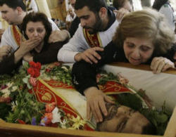 Iraqi Christians mourning the loss of one of their beloved priests killed by Muslim extremists