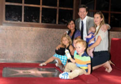 Mark Wahlberg is pictured at his Hollywood Walk of Fame star ceremony in July with his wife, Rhea, his two daughters and two sons and the family nanny, Cassie