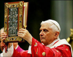 Pope Benedict carries the Book of the Gospels