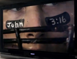 The commercial refers to the Bible verse, John 3:16, for less than 2 seconds, painted on a football player's eye black.