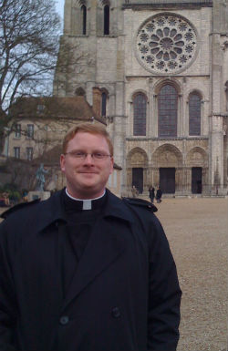 Father David Carter in front of Chartres Cathedral in France