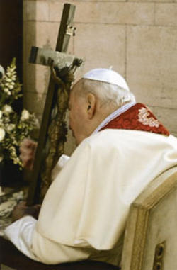 Blessed John Paul II kissing the feet of the Crucified Christ
