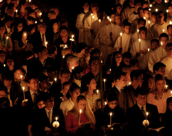Catholics participating in the Easter Vigil. Credit: Mazur