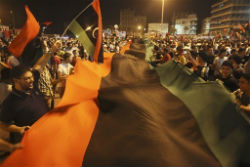 Residents of Tripoli celebrate the downfall of Moamar Gadhafi's regime.
