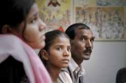 Asia Bibi with her husband and daughters before wrongful arrest