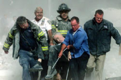Fr. Mychal Judge's body being carried out of the rubble of the Towers on 9/11/01