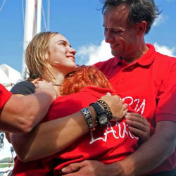 Laura Dekker, 16, hugged her family and wept before addressing the crowd. Dekker was born aboard a boat and first sailed solo at age six. At 10, she said, she began dreaming abut circling the globe.