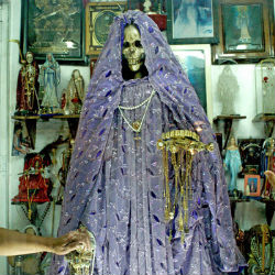 Santa Muerte, or Saint Death, is a figure revered by outlaws but whose popularity is growing across Mexico and among Hispanics in the United States.
