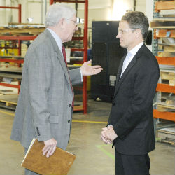 U.S. Treasury Secretary Timothy Geithner listens to Marlin Steel Wire Products board member Marshal Greenblatt during a tour of Marlin's factory in Baltimore, Maryland, earlier this month.