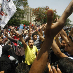 Protesters outside the court chanted slogans against the former Mubarak regime and Shafik.