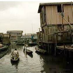 Those living in Makoko subsist largely as fishermen and workers in nearby saw mills, cutting up water-logged timber that's floated into the city daily.