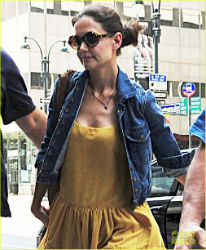 Fleeing her marriage with movie star Tom Cruise, Katie Holmes has relocated to New York City - and rejecting Cruise's Scientology, she has registered with St. Francis Xavier Catholic Church.