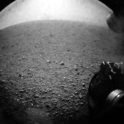 The rover transmitted a picture seven minutes later, showing one of Curiosity's wheels on the planet's gravel-strewn surface.