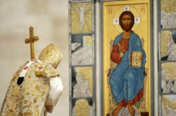 Pope Benedict XVI, the successor of Peter, bowing before an Icon of the King of Kings