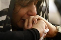 A Coptic Christian woman prays