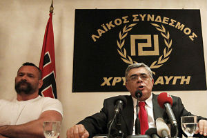 Nikolaos Michaloliakos speaking at a conference for Golden Dawn.