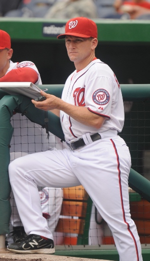 Perched atop the team dugout steps, Rick Eckstein watches his hitters. (Photo courtesy of Washington Nationals)