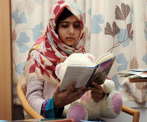 Fifteen-year-old Malala Yousafzai was shot by Taliban agents in her native Pakistan for daring to demand education for females. Recovering in Britain, she continues to flout Taliban authority by openly reading books while in the hospital.