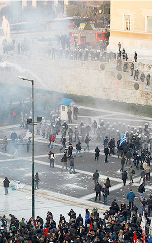 At least 80,000 people massed in Athens, where police used tear gas, stun grenades and water cannon to push back rioters. Dozens of people have been detained.