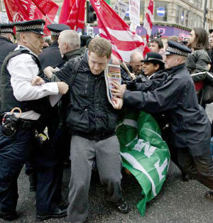 Protesters tussled with police on Oxford Street in London, in a demonstration over the dismissals of 28 Crossrail workers being held to coincide with the planned anti-austerity strikes happening across Europe.