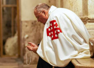 Cardinal Dolan prays in the Holy Land