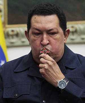 Repeatedly kissing a cross, President Hugo Chavez at one point broke out into song. 'An operation like this, an illness like this, always carries risk,' he said.