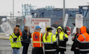 Workers on strike at the Long Beach terminal.