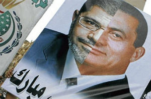 An image comparing Morsi to Mubarak has gone viral in Egypt.