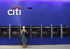 Citibank is cutting jobs and costs in the face of new regulations and fiscal uncertainty.