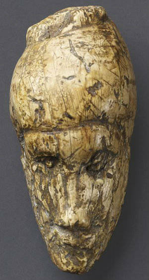 Approximately six inches tall, the portrait is carved from tusk ivory, and was damaged during excavation, causing the large missing chunk visible on the left hand side of its body.