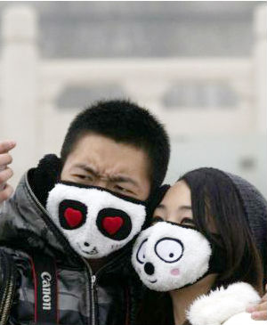 Masks have become practical fashion on Beijing's busy streets.