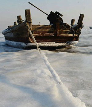 Subhuman cold has even frozen the sea in Laizhou Bay on the coast of Shandong province in the east, stranding nearly 1,000 ships, the China Daily newspaper reported.