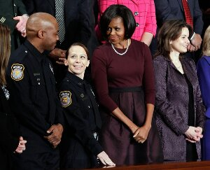 Pictured here with First Lady Michelle Obama as well as her partner Sgt. Mark Todd, Sgt. Kimberly Munley says that President Obama has neglected her and other survivors of the deadly 2009 Fort Hood shooting massacre.