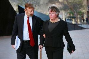 Maureen O'Connor with her attorney. Her attorney says a tumor may have made her gamble and lose a billion dollars over the past nine years.