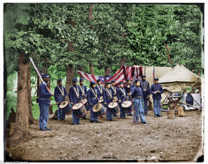 This image shows a youthful drum corps as well as the conditions in which men lived between battles.