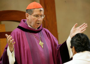 Cardinal Mahony wearing the ashes which signify repentance, during an Ash Wednesday service.