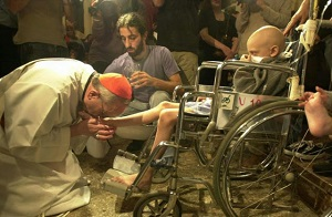 Pope Francis as a Bishop washing the feet of a young, disabled man