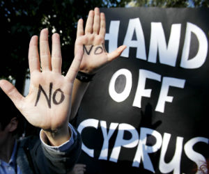 Cyprus has been crippled by the losses that its oversized banking sector sustained on investments in Greece and a deep recession.