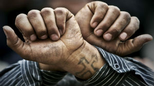 Egyptian Copts wear tattoos such as this cross, which Libyans are using as evidence of guilt.