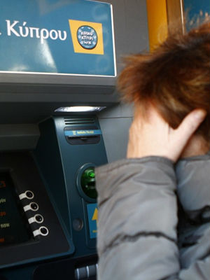 Fearful that a large percentage of their savings will be wiped out with a bail-out plan, Cypriots rushed ATMs to withdraw funds.