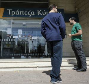 Cyprus has shut its banks until at least Thursday and delayed a parliamentary vote on the package until Tuesday.